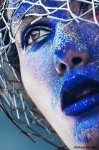 close-up portrait of woman with blue powder