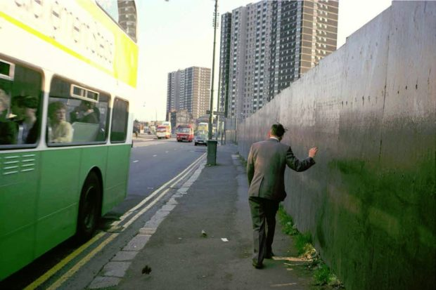 man-reeling-and-green-bus_raymond-depardon-magnum