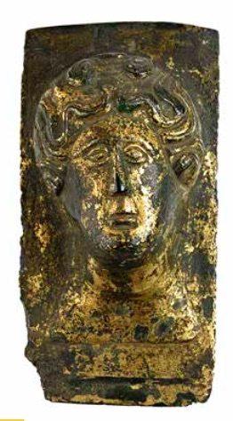 Plaque décorative à visage féminin